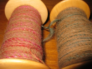 Bobbins of marled yarn