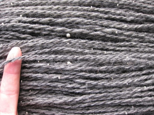 Beaded yarns require more hours for string the beads, and plying VERY slowly.