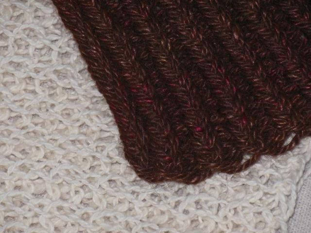 Single stitch is Kirstin's hand spun two ply lace weight, double stitch is Aunt Geri's hand spun three ply fingering weight
