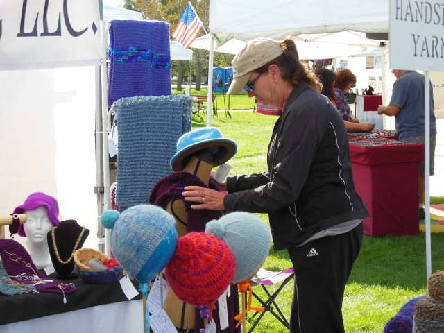 Aunt Geri arranges hats at the Summerset Festival.